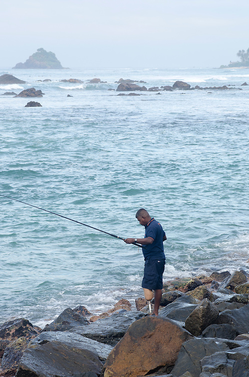 Local fisherman in Weligama, near Galle, Sri Lanka