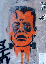 Graffiti image of Frankenstein`s monster on wall