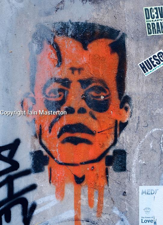 Graffiti image of Frankenstein`s monster on wall