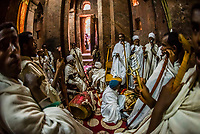 Ethiopian Orthodox men praying and chanting, Debre Sina Mikael (Church of St. Michael), one of 11 rock hewn medieval monolithic churches in  Lalibela, Ethiopia.
