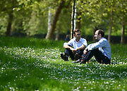 © Licensed to London News Pictures. 22/05/2012. London, UK Two men sit and talk in Hyde Park. People enjoy the sunshine in London's Royal Parks today 22 May 2012. Photo credit : Stephen Simpson/LNP