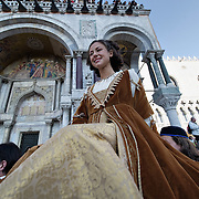 VENICE, ITALY - FEBRUARY 26:  Traditional parade of 12 beautiful Venetian  girls for the Festa delle Mariein St Mark Square on February 26, 2011 in Venice, Italy.  The Venice Carnival, one of the largest and most important in Italy, attracts thousands of people from around the world each year. The  theme for this year's carnival is 'Ottocento', a nineteenth century evocation, and will run from February 19 till March 8.