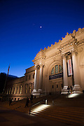 A crescent moon and the planets hang in a twilight sky above the Metropolitan Museum of Art in Manhattan, New York City, New York.