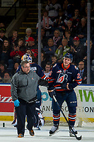 KELOWNA, CANADA - DECEMBER 29:  Kamloops Blazers' athletic therapist Collin Robinson tends to Quinn Schmiemann #25 of the Kamloops Blazers after a goal by the Kelowna Rockets on December 29, 2018 at Prospera Place in Kelowna, British Columbia, Canada.  (Photo by Marissa Baecker/Shoot the Breeze)