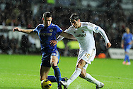 Swansea's Danny Graham (10) has a late shot blocked by Chelsea's Gary Cahill.  Barclays Premier league, Swansea city v Chelsea at the Liberty Stadium in Swansea, Swansea, South Wales on Saturday 3rd November 2012. pic by Andrew Orchard, Andrew Orchard sports photography,