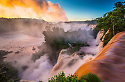 """Iguazu Falls, Iguazú Falls, Iguassu Falls or Iguaçu Falls are waterfalls of the Iguazu River on the border of the Argentine province of Misiones and the Brazilian state of Paraná. The falls divide the river into the upper and lower Iguazu. The Iguazu River rises near the city of Curitiba. The river flows through Brazil for most of its course, although most of the falls are on the Argentine side. Below its confluence with the San Antonio River, the Iguazu River forms the boundary between Argentina and Brazil.<br /> The name """"Iguazu"""" comes from the Guarani or Tupi words """"y"""", meaning """"water"""", and """"ûasú """", meaning """"big"""". Legend has it that a god planned to marry a beautiful woman named Naipí, who fled with her mortal lover Tarobá in a canoe. In rage, the god sliced the river, creating the waterfalls and condemning the lovers to an eternal fall. The first European to find the falls was the Spanish conquistador Álvar Núñez Cabeza de Vaca in 1541."""