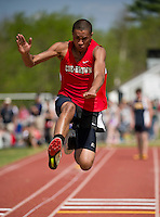 Coe-Brown's Neal Griffen takes off at the triple jump during Saturday's Invitational Track Meet hosted by Merrimack Valley High School.  (Karen Bobotas/for the Concord Monitor)