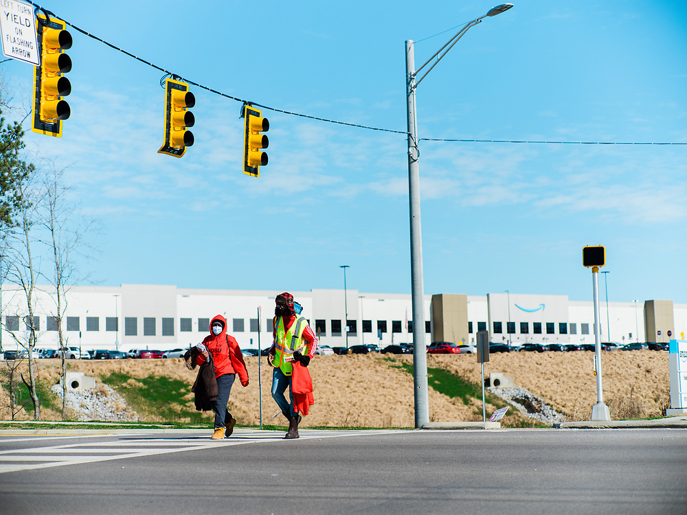 BESSEMER, AL – JANUARY 29, 2021: Union member organizers Tray Ragland, 28 (right), and Connie Carson, 41, cross the street in front of the new Amazon BHM1 fulfillment center, where union organizers from the Retail, Wholesale and Department Store Union have been rallying workers to unionize. CREDIT: Bob Miller for The Wall Street Journal<br /> AMAZONUNION