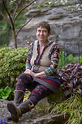 Becky Gillette, sits near a spring on Monday, April 13, 2015, in Eureka Springs, Ark. Gillette is a Sierra Club activist, who is fighting to ban and raise awareness about wood products containing formaldehyde.