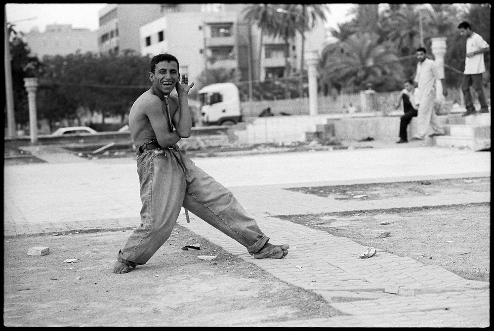 A glue-sniffing street kid poses for a photographer in the square outside the Palestine Hotel in central Baghdad.