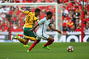 Raheem Sterling of England fouling Egidijus Vaitkunas of Lithuania during the FIFA World Cup Qualifier group stage match between England and Lithuania at Wembley Stadium, London, England on 26 March 2017. Photo by Matthew Redman.