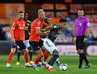 Football - 2020 / 2021 EFL Carabao Cup - Round Three - Luton Town vs Manchester United<br /> <br /> Manchester United's Jesse Lingard holds off the challenge from Luton Town's Danny Hylton, at Kenilworth Road.<br /> <br /> COLORSPORT/ASHLEY WESTERN