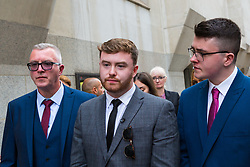Niall Galbally, centre, the son of Catherine Burke, flanked by his father, left and half brother gives a statement outside The Old Bailey in London following the sentencing of Kasim Lewis for the murder of his mother. London, July 18 2019.