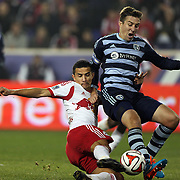 Tim Cahill, (left0, New York Red Bulls, has his shot blocked by Matt Besler, Sporting Kansas City, during the New York Red Bulls V Sporting Kansas City, Major League Soccer Play Off Match at Red Bull Arena, Harrison, New Jersey. USA. 30th October 2014. Photo Tim Clayton
