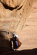 Zedane al-Zalabieh, owner of Bedouin Meditation Camp, stands at the base of Um Frouth Arch in Wadi Rum, Jordan.