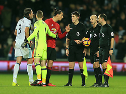 17 December 2016 - Premier League - West Bromwich Albion v Manchester United -Zlatan Ibrahimovic of Manchester United is pulled away from the officials by David De Gea - Photo: Paul Roberts / Offside.
