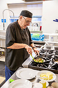 Working senior man kitchen