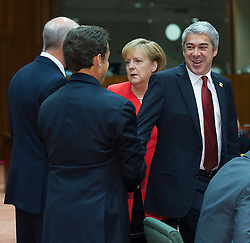 Jose Socrates, Portugal's prime minister, right, greets Nicolas Sarkozy, France's president, left, as Angela Merkel, Germany's chancellor, center, speaks with George Papandreou, Greece's prime minister, back left, during the European Summit meeting at EU Council headquarters in Brussels, Belgium, on Thursday, June 17, 2010. (Photo © Jock Fistick)