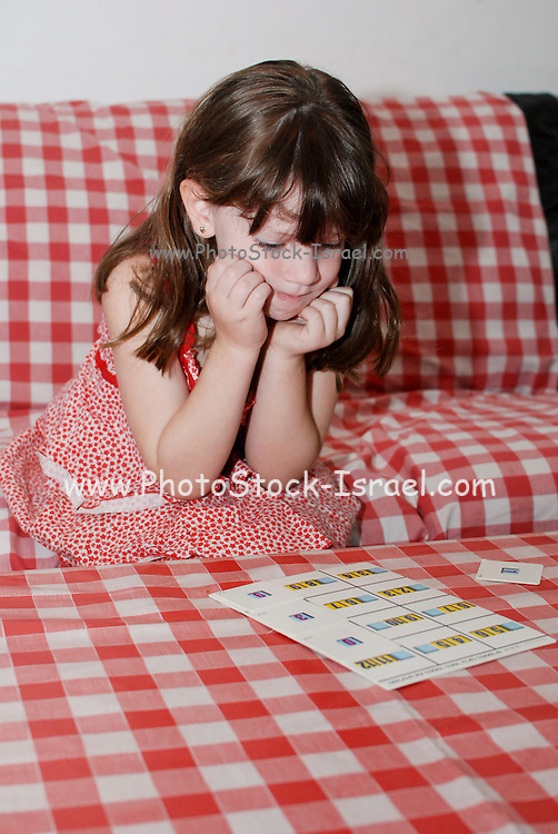 Young preschool girl of 5 learns arithmetic