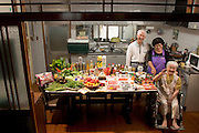 The Matsuda family in the kitchen of their home in Yomitan Village, Okinawa, with a week's worth of food. Takeo Matsuda, 75, and his wife Keiko, 75, stand behind Takeo's mother, Kama, 100. The couple's three grown children live a few miles away. From the book Hungry Planet: What the World Eats (Model Released)