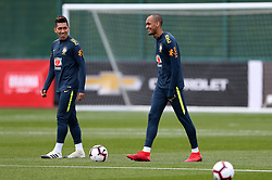 Brazil's Fabinho (right) and Roberto Firmino during the training session at London Colney, Hertfordshire.