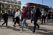 Commuters and other pedestrians walk over London Bridge, the oldest of the capital's crossing over the river Thames between the capital's financial district, the City of London, and Southwark on the south bank, on 6th June 2018, in London, UK.