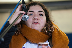 London, UK. 1st December, 2018. Beatriz Ratton of Brazilian Women Against Fascism addresses the Together for Climate Justice demonstration against Government policies in relation to climate change, including Heathrow expansion and fracking. Following a rally outside the Polish embassy, chosen to highlight the UN's Katowice Climate Change Conference which begins tomorrow, protesters marched to Downing Street.