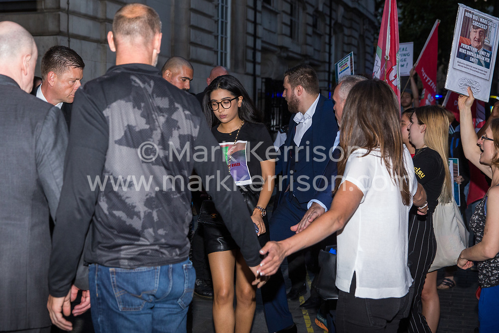 London, UK. 12 July, 2019. Members of the Cleaners and Facilities Branch of the IWGB (Independent Workers of Great Britain) trade union urge guests not to enter 5 Hertford Street in Mayfair, which also houses exclusive private club Loulou's, during a protest to call for its kitchen porters, recently outsourced through ACT Clean, to be paid the London Living Wage and given terms and conditions including suitable sick pay, holidays and pension contributions. Numerous unmarked security guards were present outside the venue.