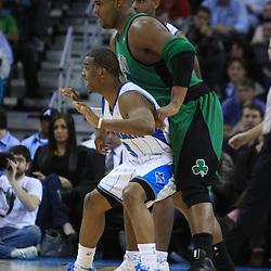 11 February 2009:  New Orleans Hornets guard Chris Paul (3) posts up against Boston Celtics forward Glen Davis (11) during a 89-77 loss by the New Orleans Hornets to the Boston Celtics at the New Orleans Arena in New Orleans, LA.