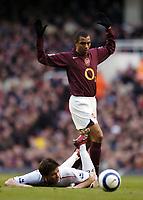 Photo: Olly Greenwood.<br />Arsenal v Liverpool. The Barclays Premiership. 12/03/2006. Arsenal's Gilberto fouls Liverpool's Xabi Alonso