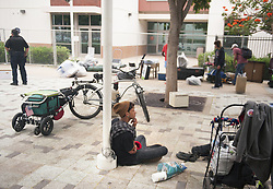 August 7, 2017 - Tustin, CA, USA - Peter Frias, 20, waits with his belongings as others pack up their belongings at the civic center in Tustin, CA on Monday, August 7, 2017. The city posted signs at the civic center telling people living in the homeless encampment that they must move out by 8 a.m. to make way for a temporary library. (Credit Image: © Ken Steinhardt/The Orange County Register via ZUMA Wire)