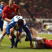 Manchester United's Mikael Silvestre and John O'Shea combine to stop Deportivo La Coruna's Scaloni