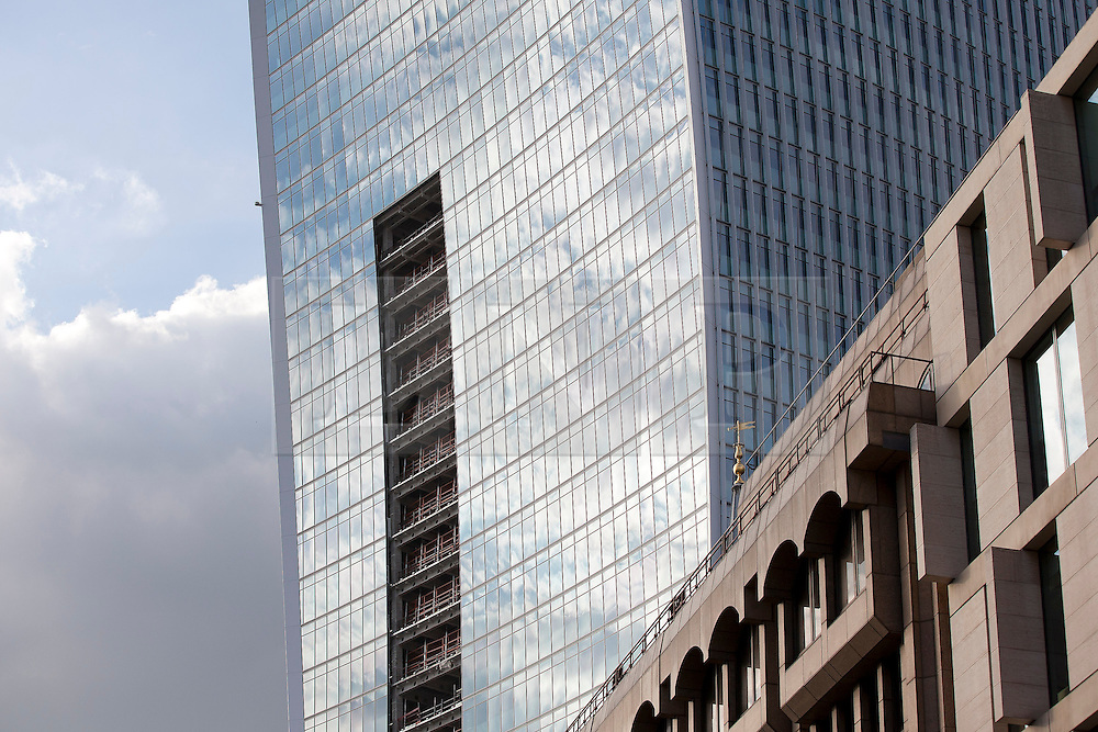 © Licensed to London News Pictures. 03/09/2013. London, UK. The curved windows of the 'Walky Talkie' building, also known as 20 Fenchurch Street, are seen in London today (03/09/2013). The building, still under construction, has hit headlines after it was found that, due to it's curved architecture, light reflected from the building at certain times of the day was melting cars and has the ability to cook eggs. Photo credit: Matt Cetti-Roberts/LNP