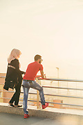 Rear view of couple looking at sea view at sunset, Casablanca, Morocco