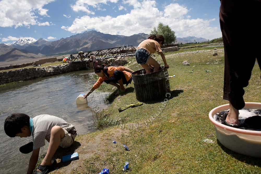 A local family is washing clothes near Leh, the capital of Ladhakh, along the Leh-Manali Highway.