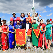"""The mainland Chinese singing together I Love My Country (我爱我的国家) The China-Britain Dress Art Festival and the celebration of Great China 70th Anniversary 2019. A """"Qipao"""" Flash Torch relay began at Portsmouth. The mainland Chinese in 28 counties and cities across Britain will participate in the thousands of cheongsams and end in London on the 28 September 2019, UK."""