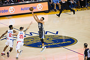 Golden State Warriors guard Stephen Curry (30) shoots a near-mid-court three pointer at the buzzer of the first quarter against the LA Clippers at Oracle Arena in Oakland, California, on February 22, 2018. (Stan Olszewski/Special to S.F. Examiner)