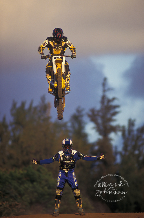 Motocross rider jumping over a friend, Kauai, Hawaii ****Model Release available