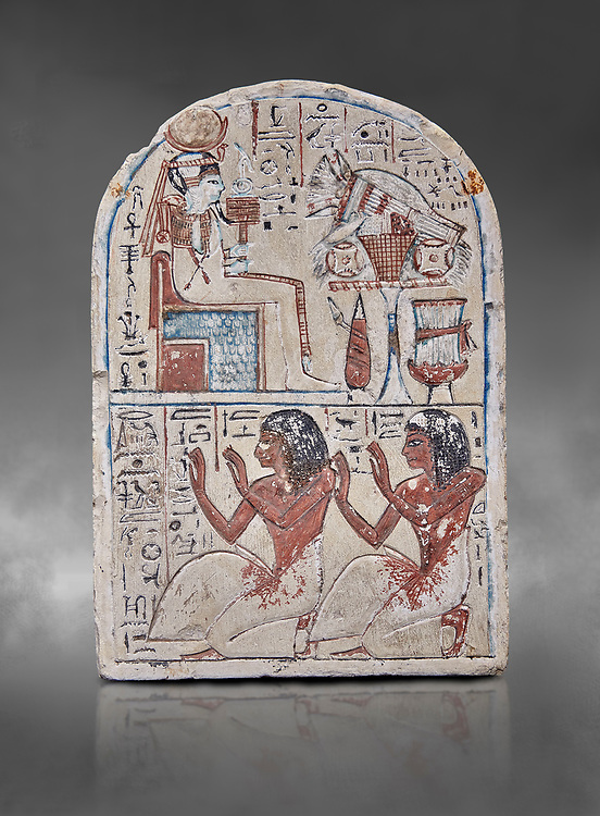 """Ancient Egyptian Ra stele , limestone, New Kingdom, 19th Dynasty, (1279-1190 BC), Deir el-Medina,  Egyptian Museum, Turin. Grey background.<br /> <br /> Khonsu sits on a cube-like throne and wears the solar disc and half-moon on his head. He faces an offering table piled with food and flowers. The hieroglyphic inscription reads: """"Khonsu-in-Thebes, Neferhotep. Protection, life, stability and power surround him, like Ra. Libation for your ka with bread, beer, oxen and fowl.""""Lower register depicts two men kneeling in adoration. They face to the left: Nebre, whose title is kedw sesh """"draughtsman"""" and his son, Amenemope.""""Give praise to Khonsu-in-Thebes by the scribe of Amun in the Place of Truth Nebra, justified in peace, he loved his son, Amenemope, justified"""".In the bottom register are the """"Draughtsman-scribe of Amun in the Place of Truth"""", Nebre, and his son, Amenemope"""" Akh iqer en Ra """" the excellent spirit of Ra' stele.<br /> <br /> One of three stele forund in different rooms of houses in Deir el-Medina where they stood in niches .<br /> <br /> If you prefer to buy from our ALAMY PHOTO LIBRARY  Collection visit : https://www.alamy.com/portfolio/paul-williams-funkystock/ancient-egyptian-art-artefacts.html  . Type -   Turin   - into the LOWER SEARCH WITHIN GALLERY box. Refine search by adding background colour, subject etc<br /> <br /> Visit our ANCIENT WORLD PHOTO COLLECTIONS for more photos to download or buy as wall art prints https://funkystock.photoshelter.com/gallery-collection/Ancient-World-Art-Antiquities-Historic-Sites-Pictures-Images-of/C00006u26yqSkDOM"""