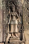 Detail of a carving at Bayon, inside Angkor Thom, at Angkor Archaeological Park in Siem Reap, Cambodia.