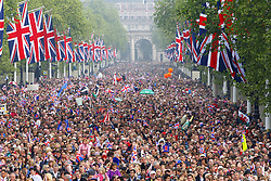 File photo dated 29/04/11 of crowds on the Mall outside Buckingham Palace after the wedding ceremony of Prince William to Kate. The Duchess of Cambridge will have spent a decade as an HRH when she and the Duke of Cambridge mark their 10th wedding anniversary on Thursday. Issue date: Wednesday April 28, 2021.