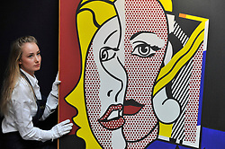 """© Licensed to London News Pictures. 06/10/2017. London, UK. A technician presents a """"Female Head"""", 1977, by Roy Lichtenstein at a preview at Sotheby's in New Bond Street of contemporary, impressionist and modern art works to be auctioned in New York in November 2017 Photo credit : Stephen Chung/LNP"""