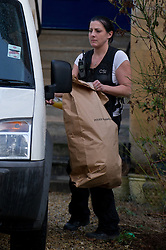 licensed to London News Pictures. 05/05/2011. Vincent Tabak who is charged with the murder of Jo Yeates whose body was found near Bristol on Christmas Day has admitted manslaughter but denied murder.  FILE PICTURE DATED.05/01/2011 A CSI places a bag of police evidence in a van at the flat of Jo Yeates, whose body was found on Christmas Day 2010. The investigation continues, with new information being released today (05/01/2011) regarding a missing sock. Picture credit should read: David Hedges/LNP