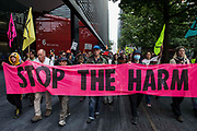 Environmental activists from Extinction Rebellion march from City Hall to London Bridge on the ninth day of their Impossible Rebellion protests on 31st August 2021 in London, United Kingdom. Extinction Rebellion are calling on the UK government to cease all new fossil fuel investment with immediate effect.