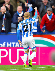 Huddersfield Town's Alex Pritchard celebrates scoring his side's first goal of the game during the Premier League match at the John Smith's Stadium, Huddersfield.