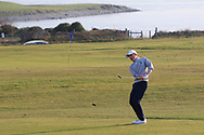 Max Kennedy (Royal Dublin) chipping onto the 18th green during Round 3 of The West of Ireland Open Championship in Co. Sligo Golf Club, Rosses Point, Sligo on Saturday 6th April 2019.<br /> Picture:  Thos Caffrey / www.golffile.ie