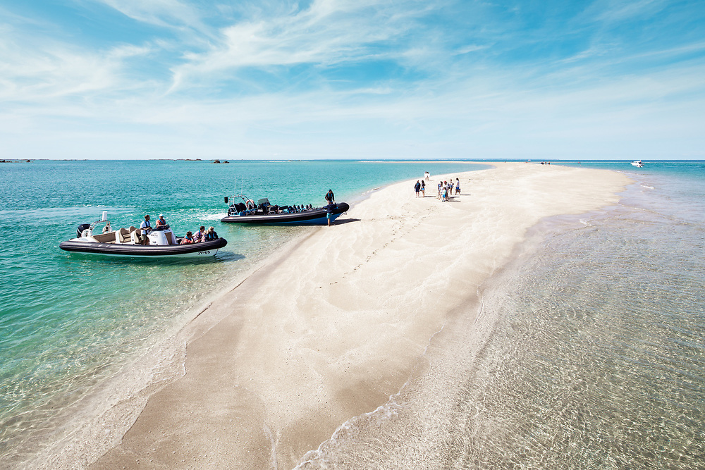 Seafaris ribs arriving at the tropical paradise of white sands and crystal clear, turquoise waters at the Minquiers off the coast of Jersey, Channel Islands