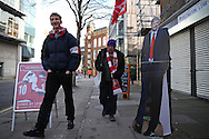 Arsenal fans walk past a life size cardboard cutout of Arsene Wenger, the Arsenal manager outside Emirates Stadium before k/o. The Emirates FA cup, 4th round match, Arsenal v Burnley at the Emirates Stadium in London on Saturday 30th January 2016.<br /> pic by John Patrick Fletcher, Andrew Orchard sports photography.