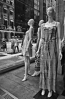 Mannequins quietly observing unsuspecting passersby in Fifth Avenue in Midtown Manhattan