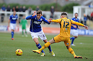 Chesterfield's Jay O'Shea (l) is tackled  by Newport's Robbie Willmott. Skybet football league two match, Newport county v Chesterfield at Rodney Parade in Newport, South Wales on Sunday 1st Dec 2013. pic by Andrew Orchard, Andrew Orchard sports photography,